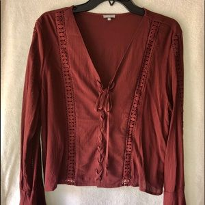 Peasant type, Lace up top with bell sleeves.